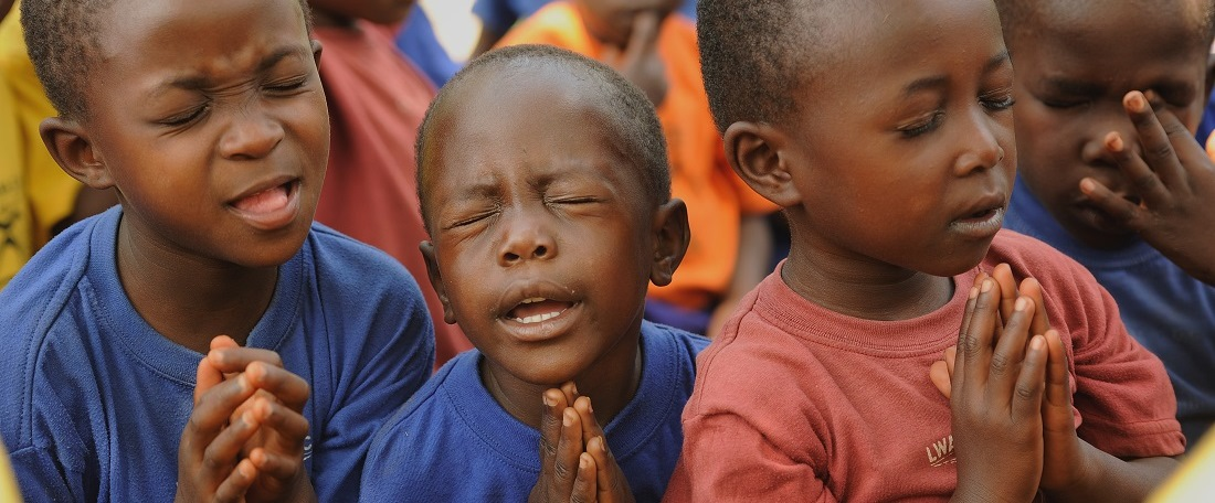 Ugandan sponsored children praying