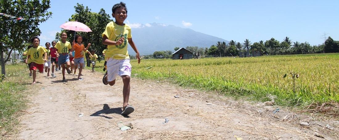 Children running in the Philippines