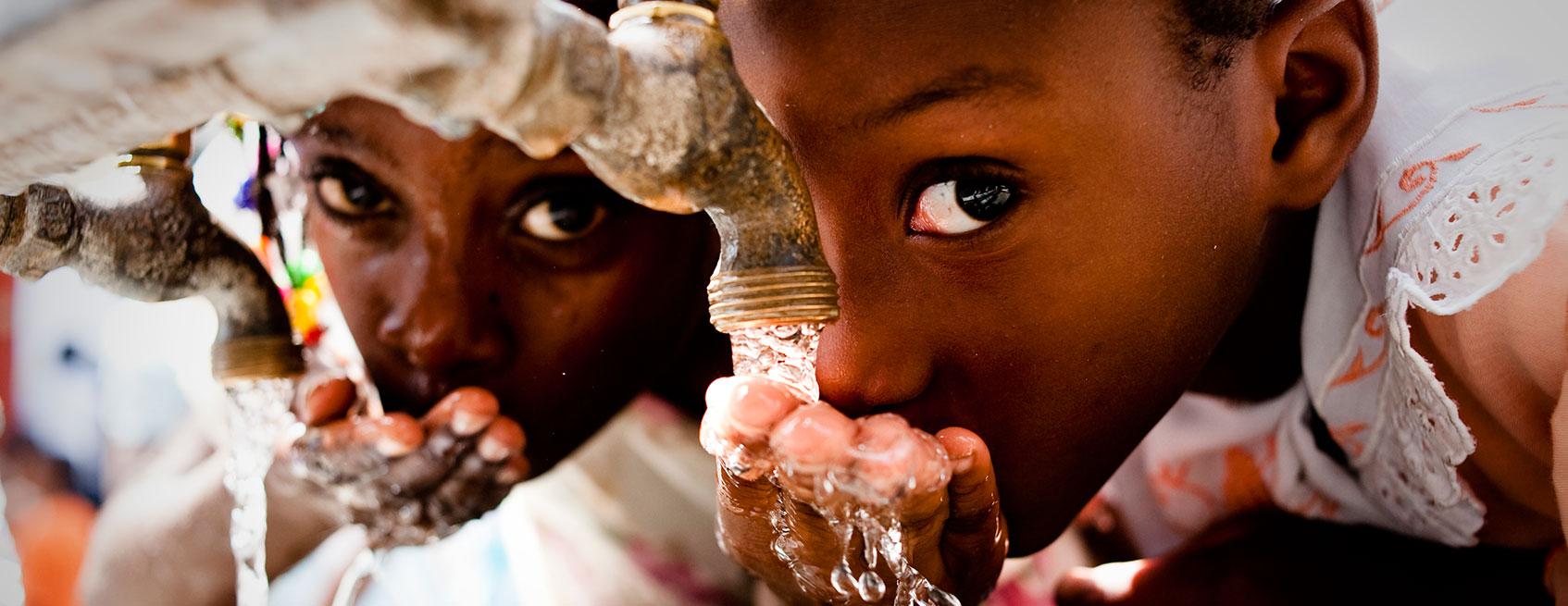 Haitian girls drinking water