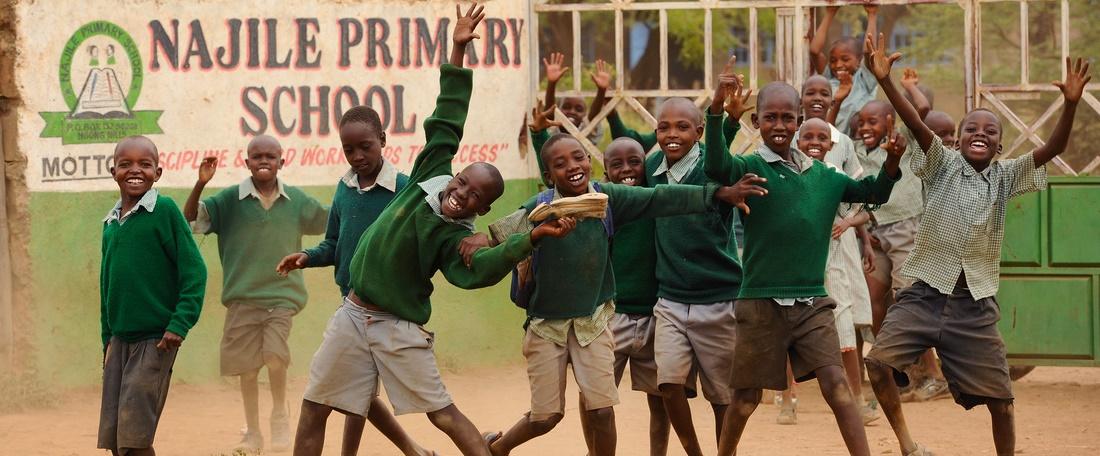 Kenya school boys outside the gates