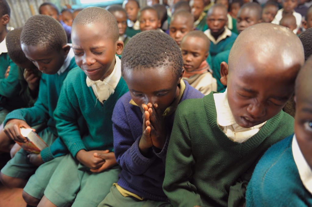 Sponsored children pray