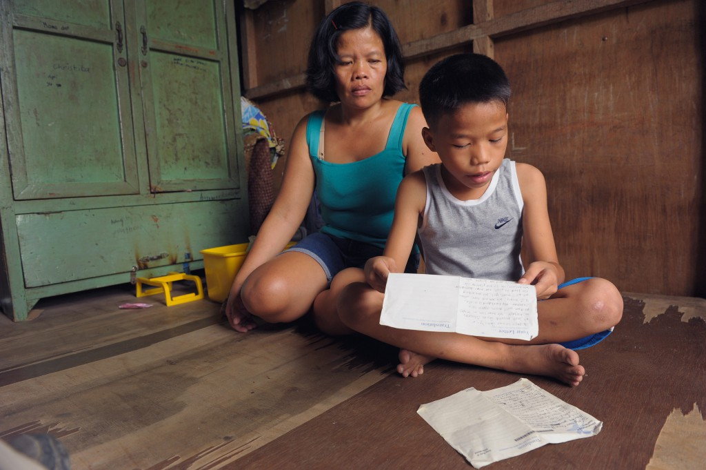 7-year-old Jose from the Philippines tucks his letters away in the family cabinet
