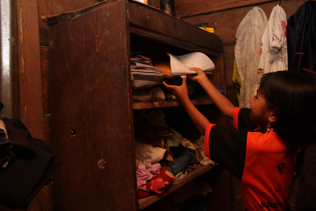 Mariana from Indonesia reaching up to the shelf where she stores all her letters