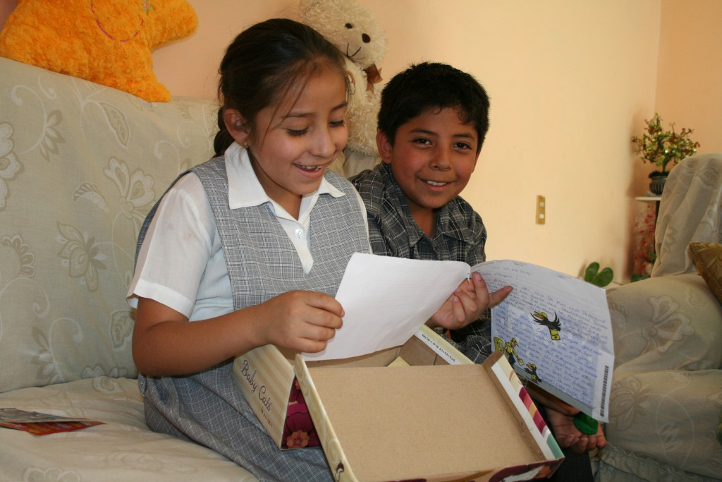 8-year-old Belinda from Mexico showing her letters to her brother
