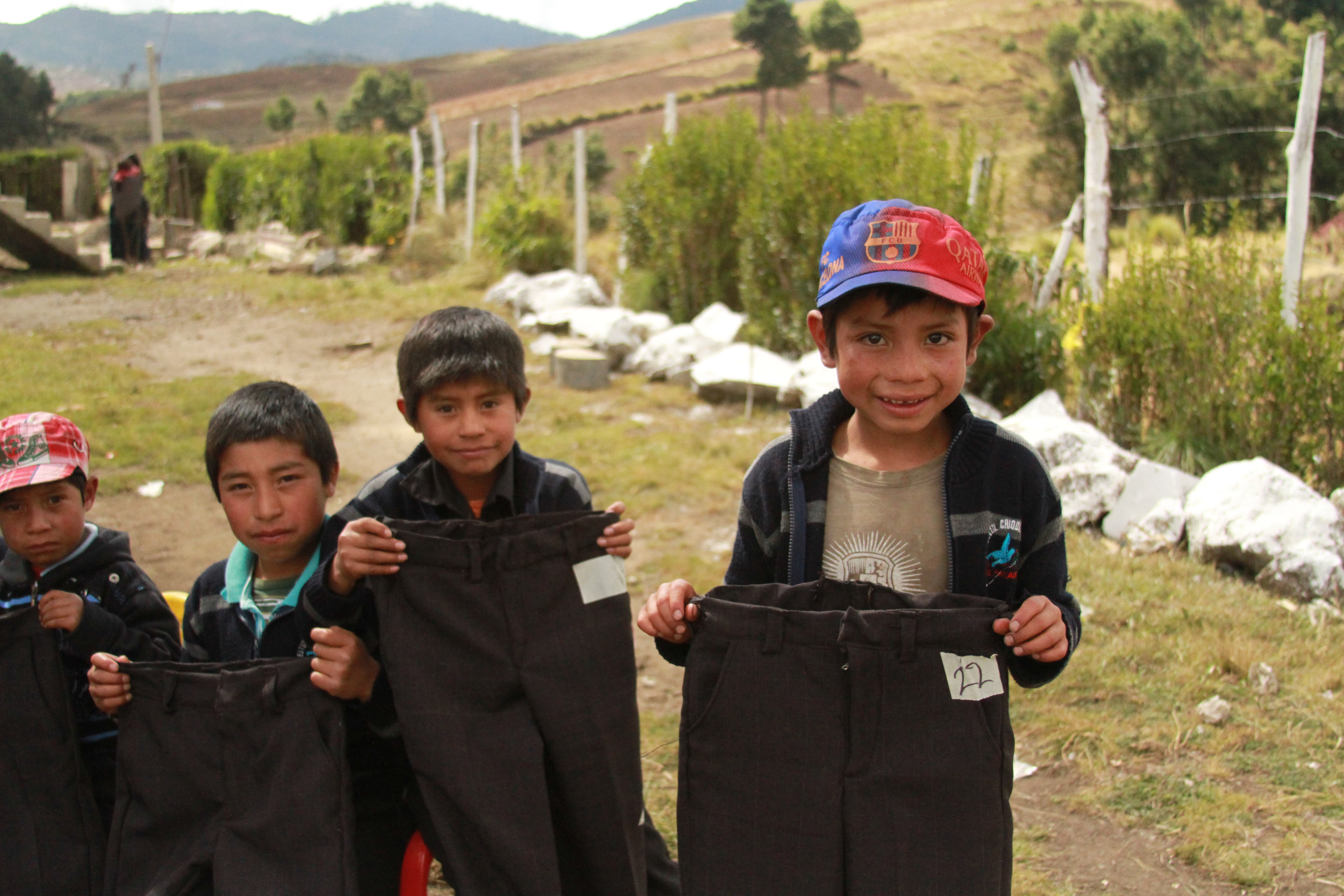Guatemalan children with the clothes they received for Christmas
