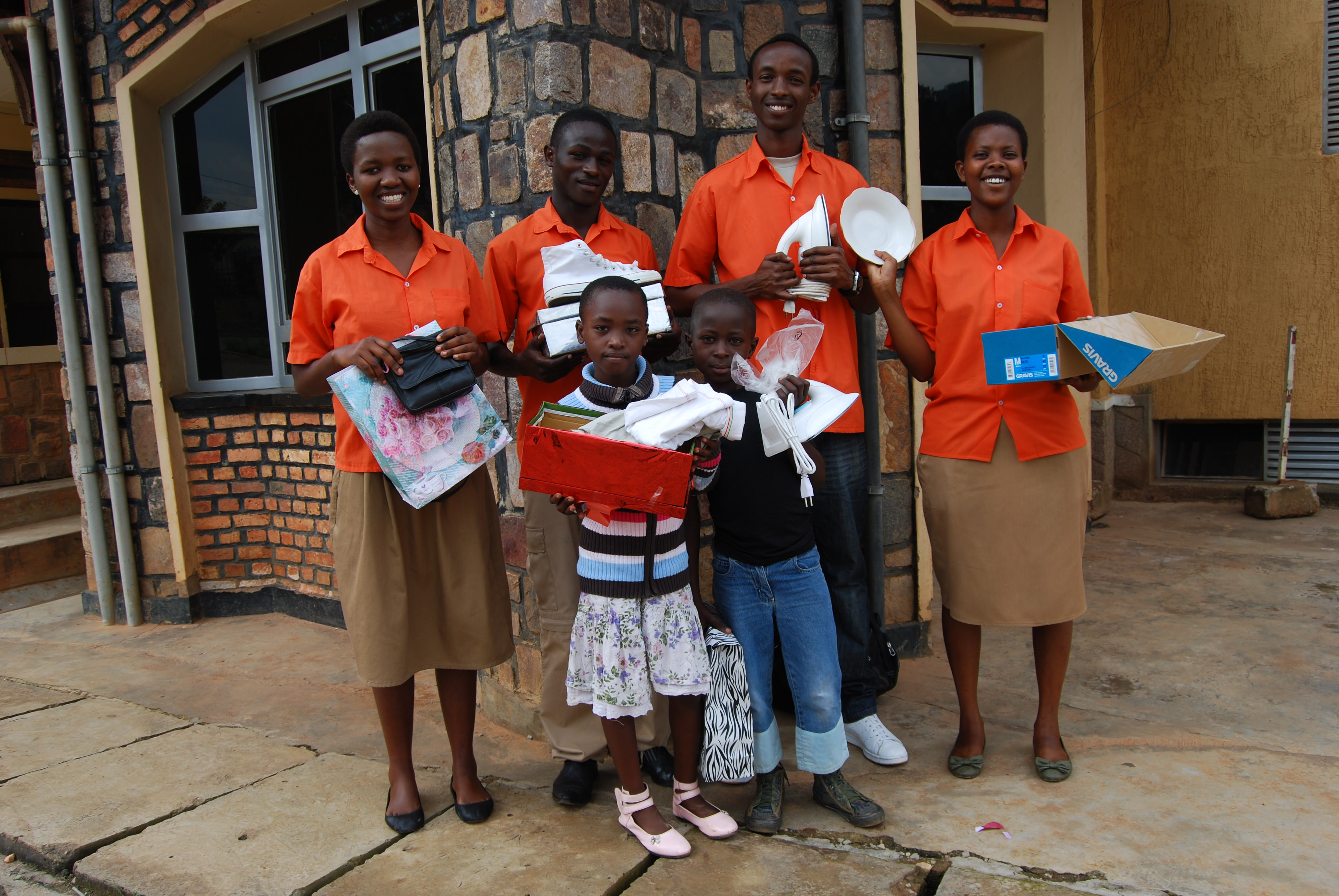 Teenagers in Rwanda with a variety of Christmas presents