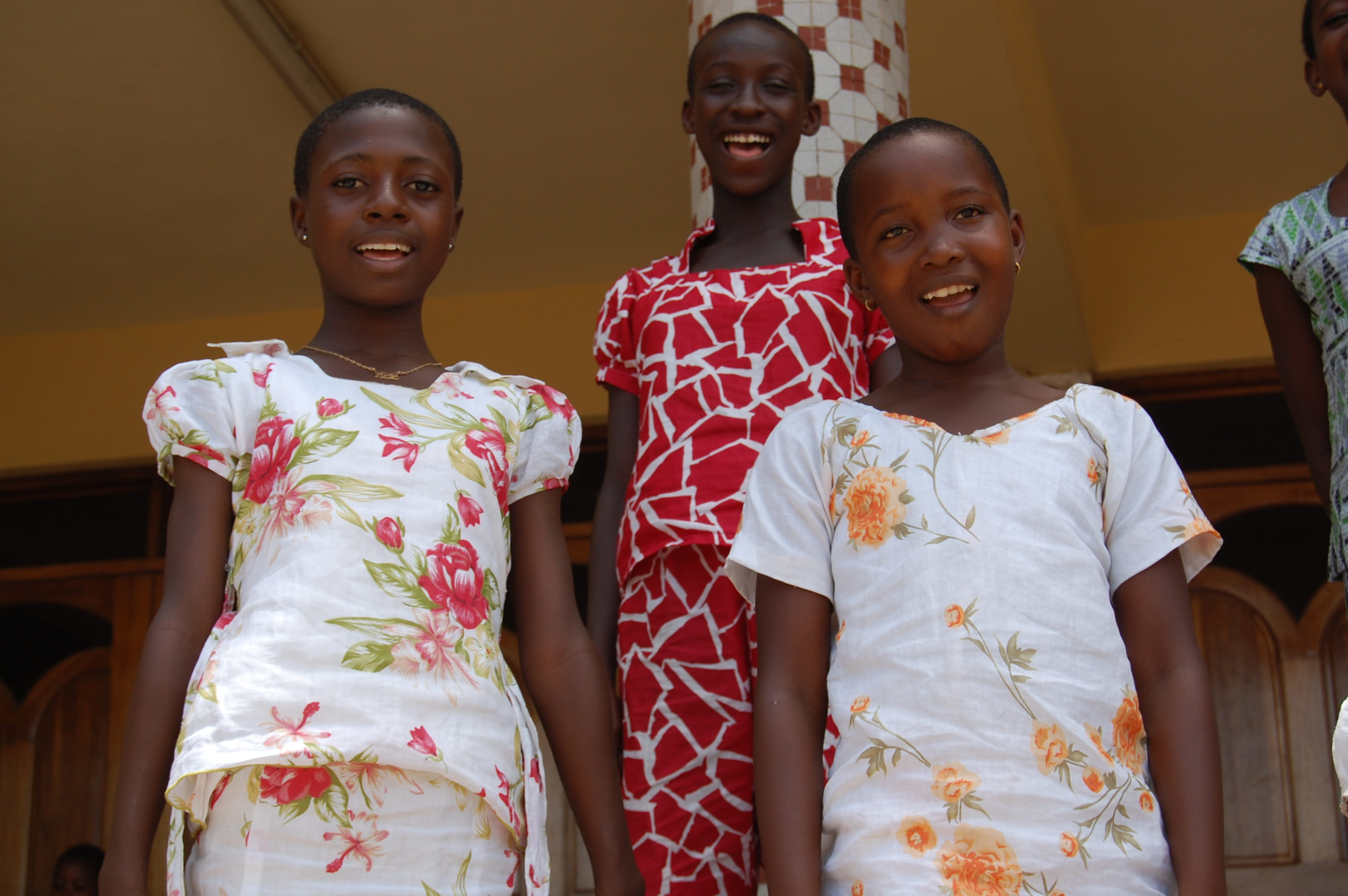 Sponsored children in Ghana with their Christmas dresses