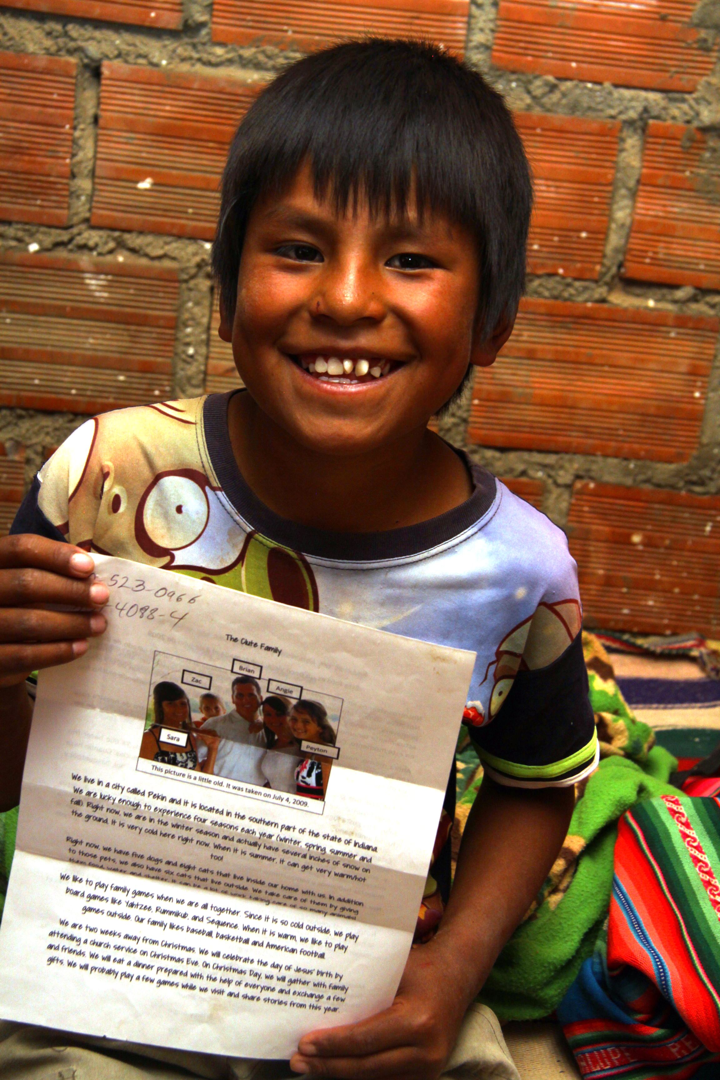 Bolivian sponsored child with letters