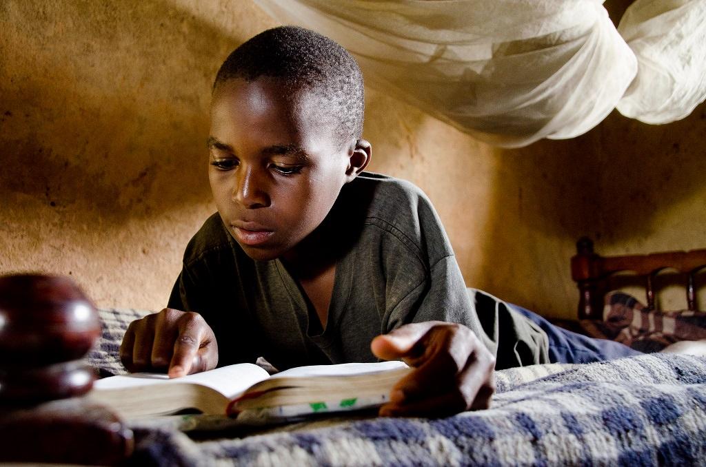 Julius reading his Bible