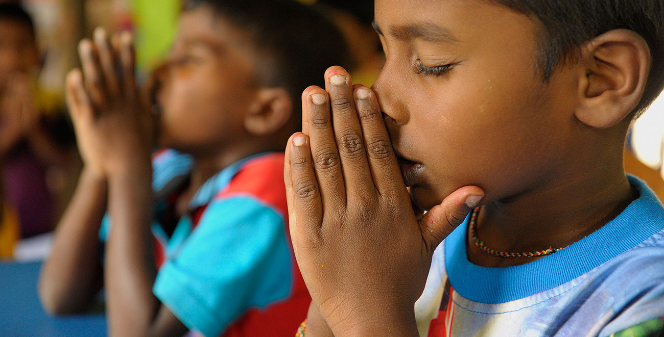 Sri Lankan boy praying
