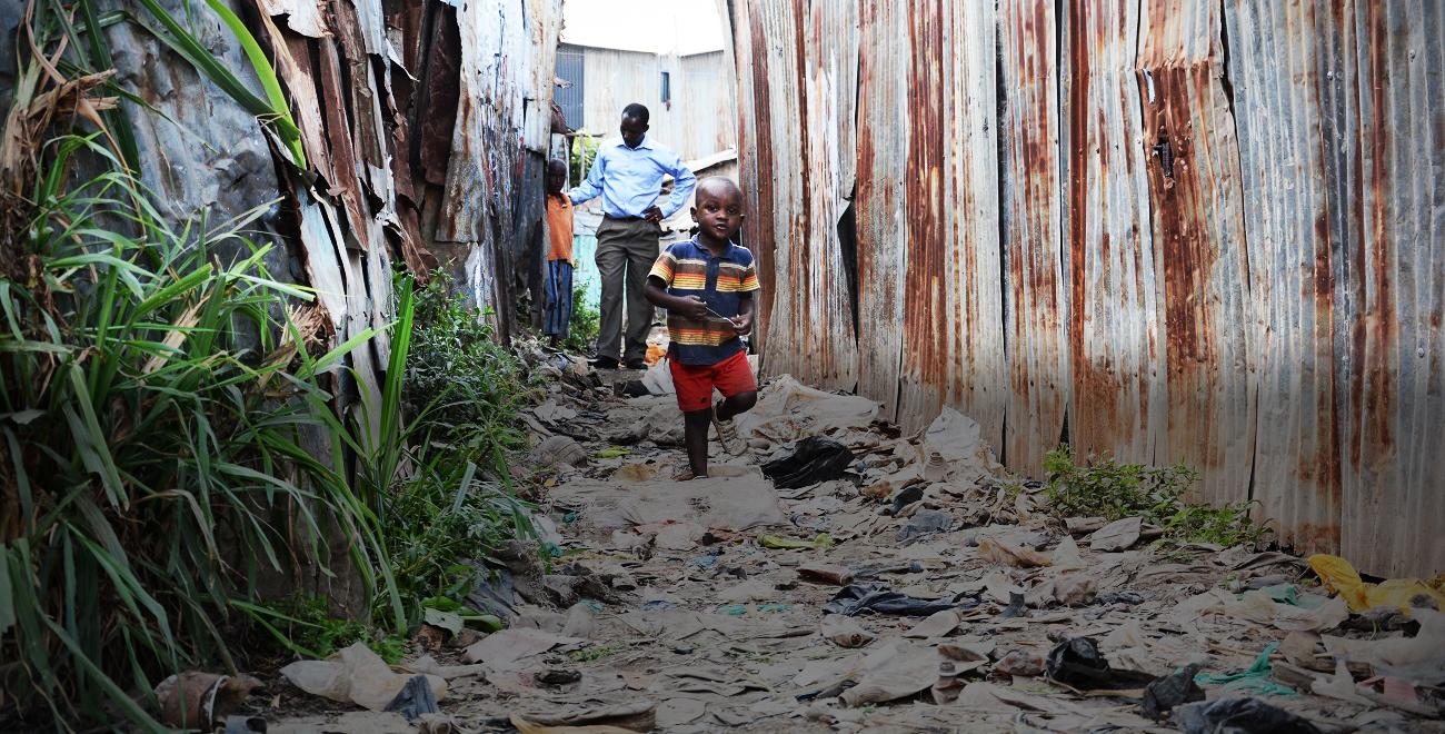 Child running through Kiambiu