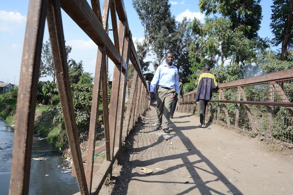 Walking over the bridge to Kiambiu slum