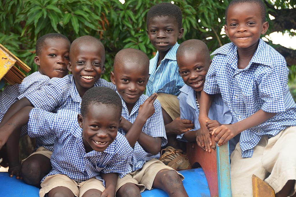 Group of smiling boys in school uniform