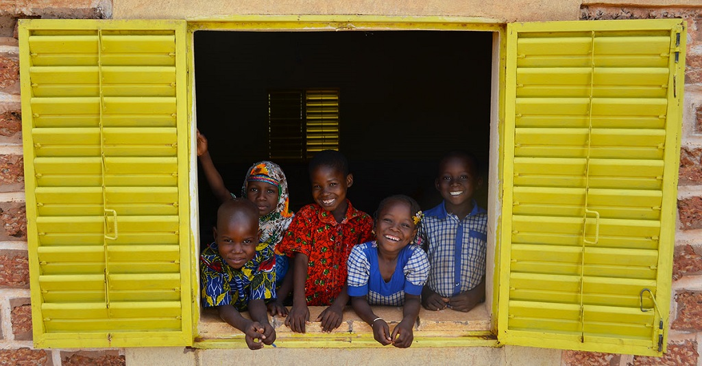 Children in Burkina Faso leaning out of door