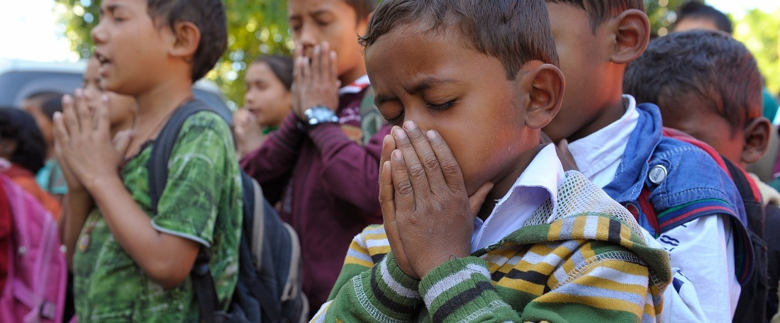 Children praying in East India