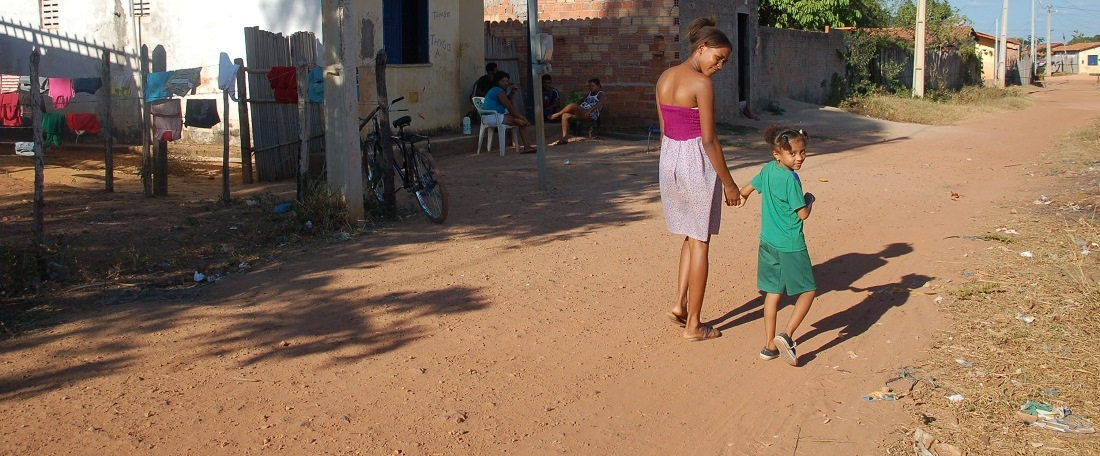 Brazilian mother walking with her child