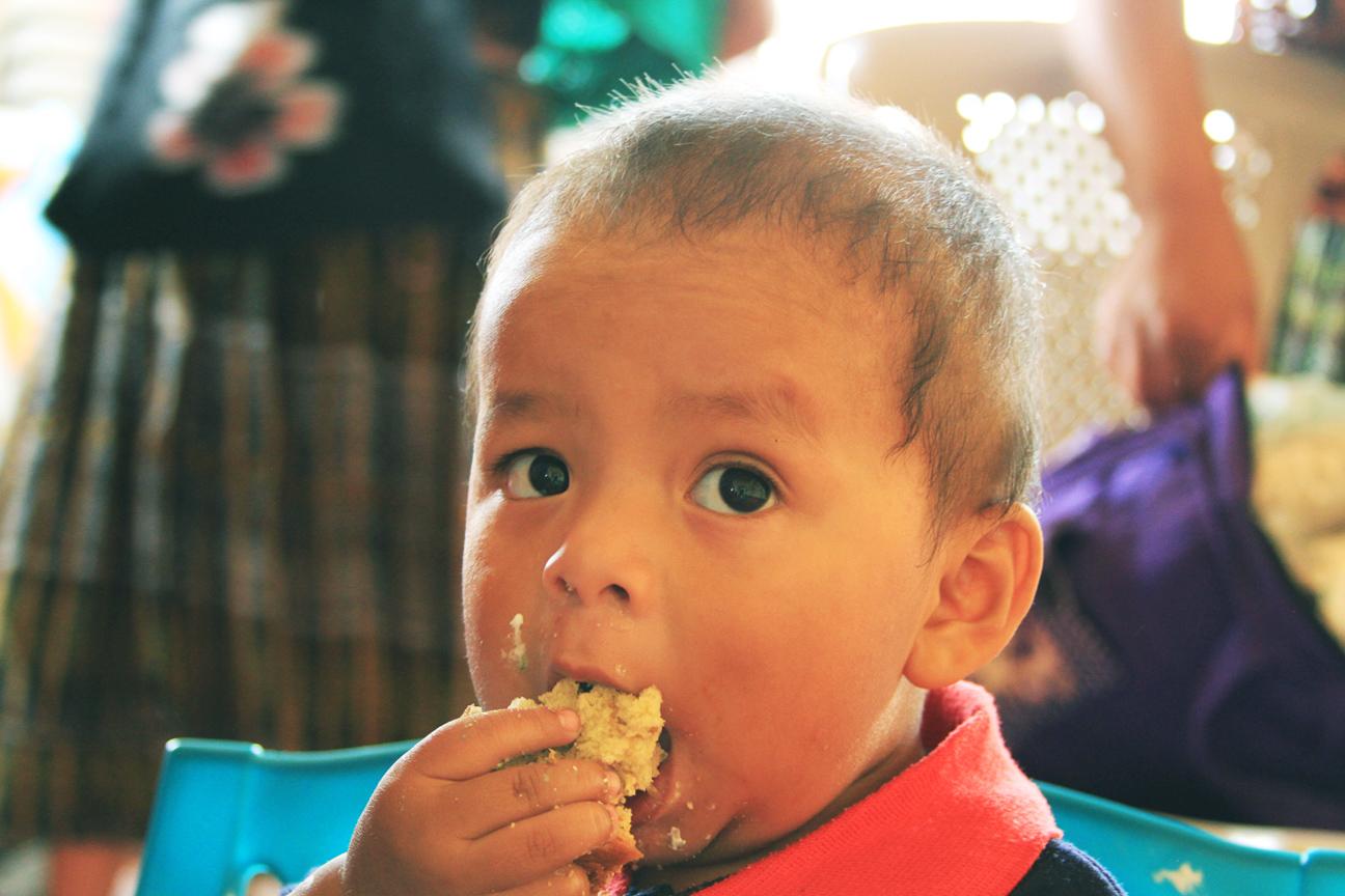 Guatemalan baby eating dinner
