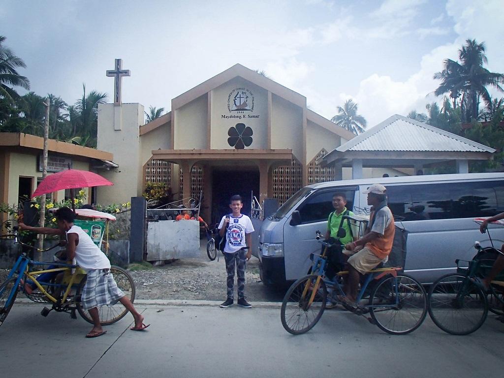 Sponsored child Joshua outside Philippines church