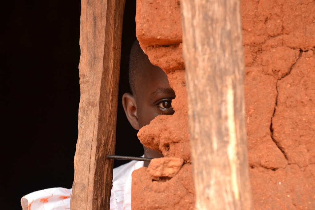 Koki looking from behind a wall