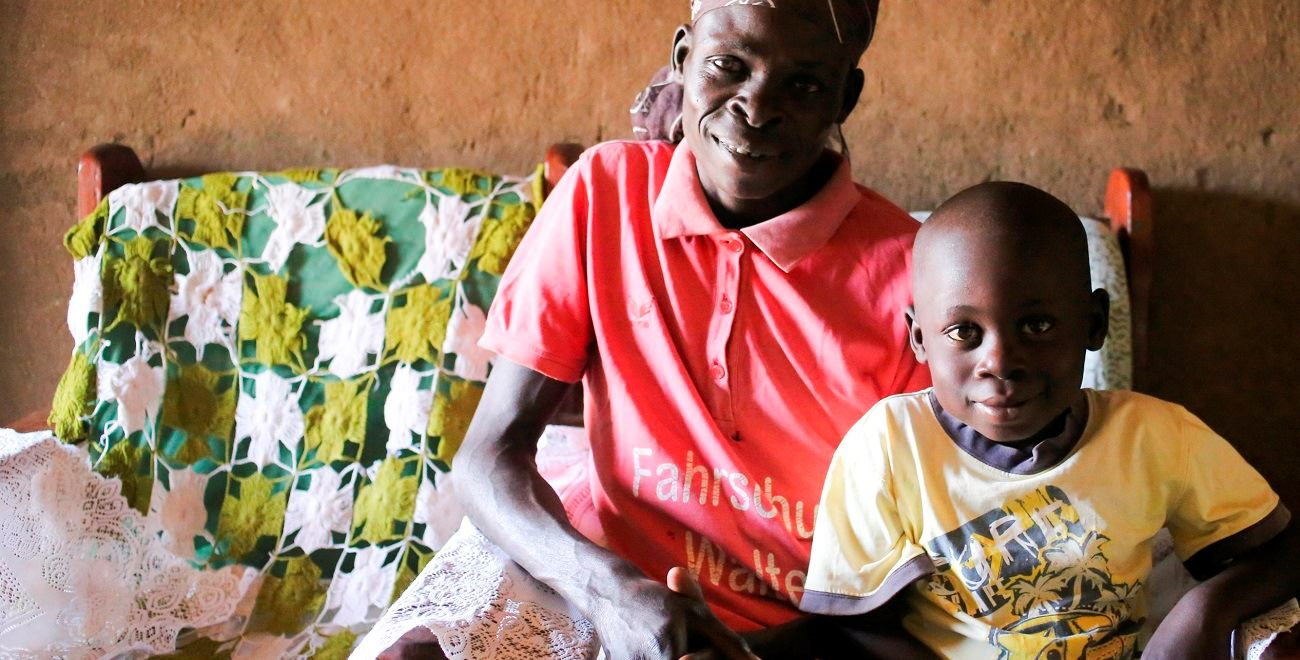 Ugandan sponsored child Moses with his mum