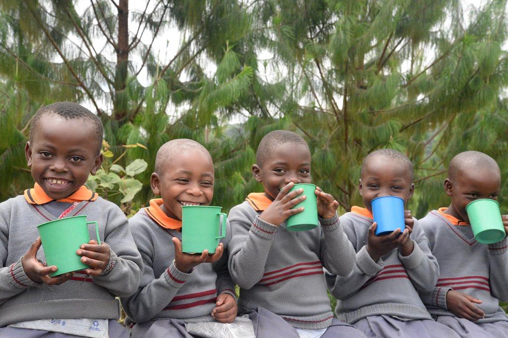 Children drinking in Uganda.
