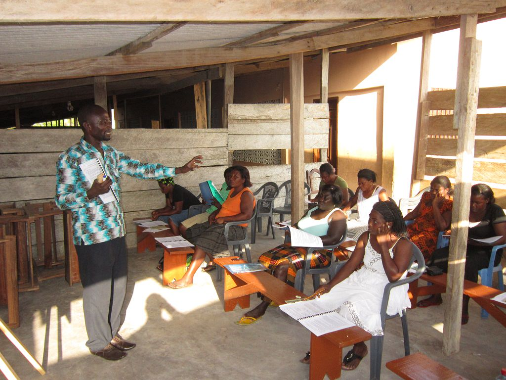 Compassion project worker Henry giving child protectiopn training