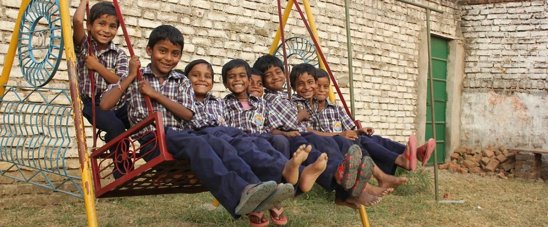 Indian children on swing