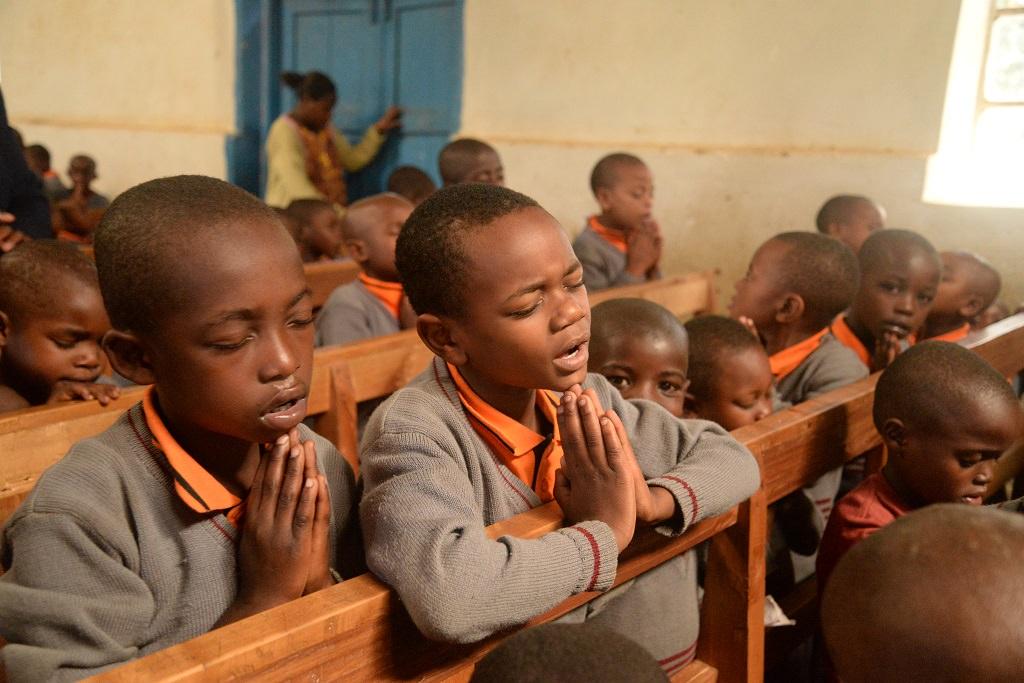 Children praying in Uganda