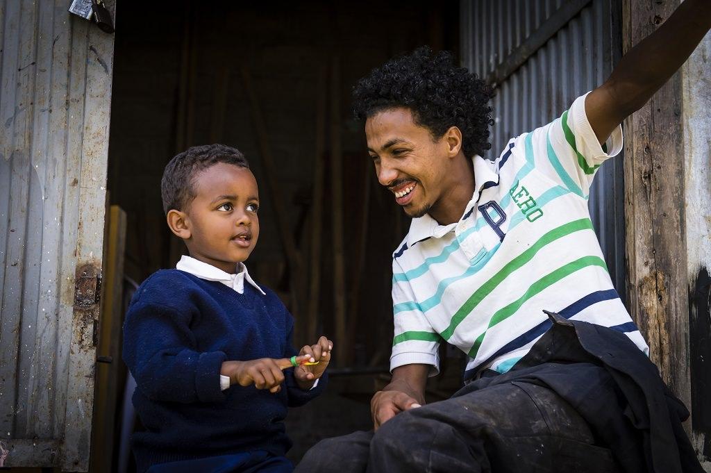 Sameson mentoring a young boy