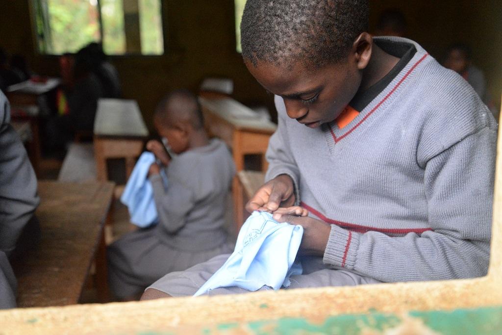 Tailoring lesson Uganda