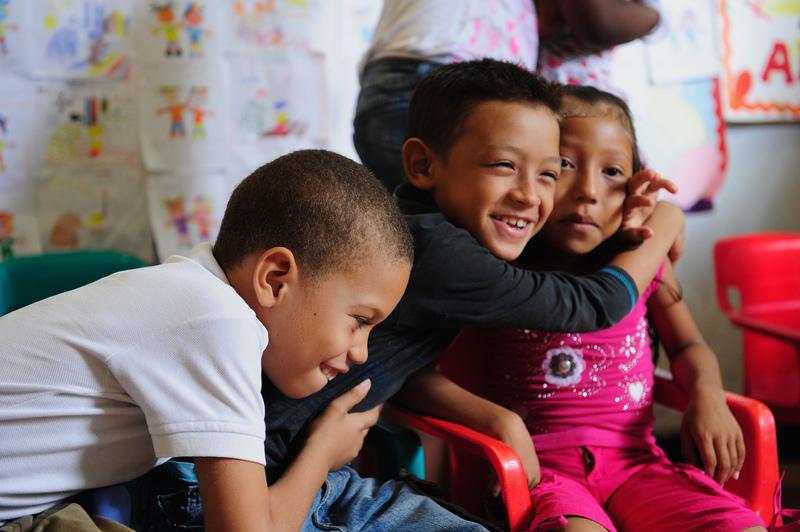 Colombian children hugging