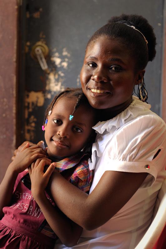 Haiti siblings hug