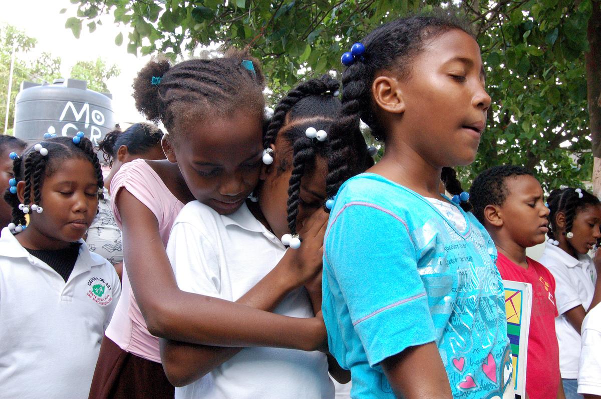 Children hugging in Haiti