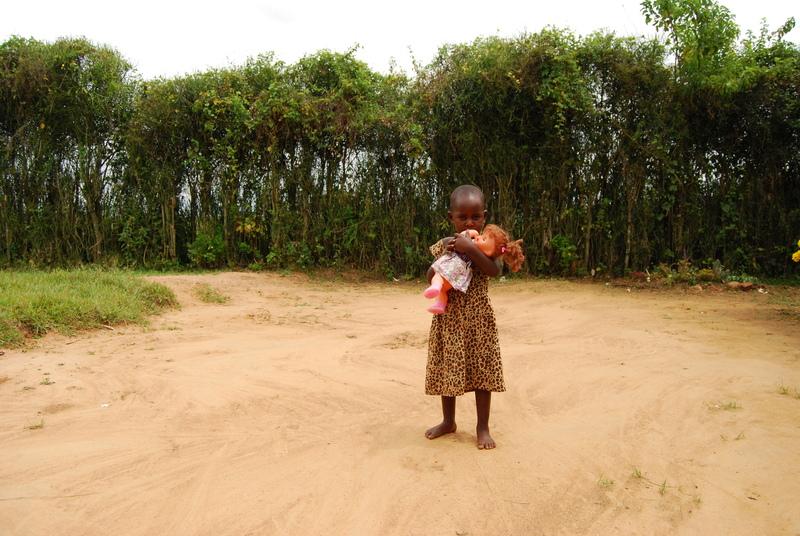 Ghanaian sponsored child hugs her doll