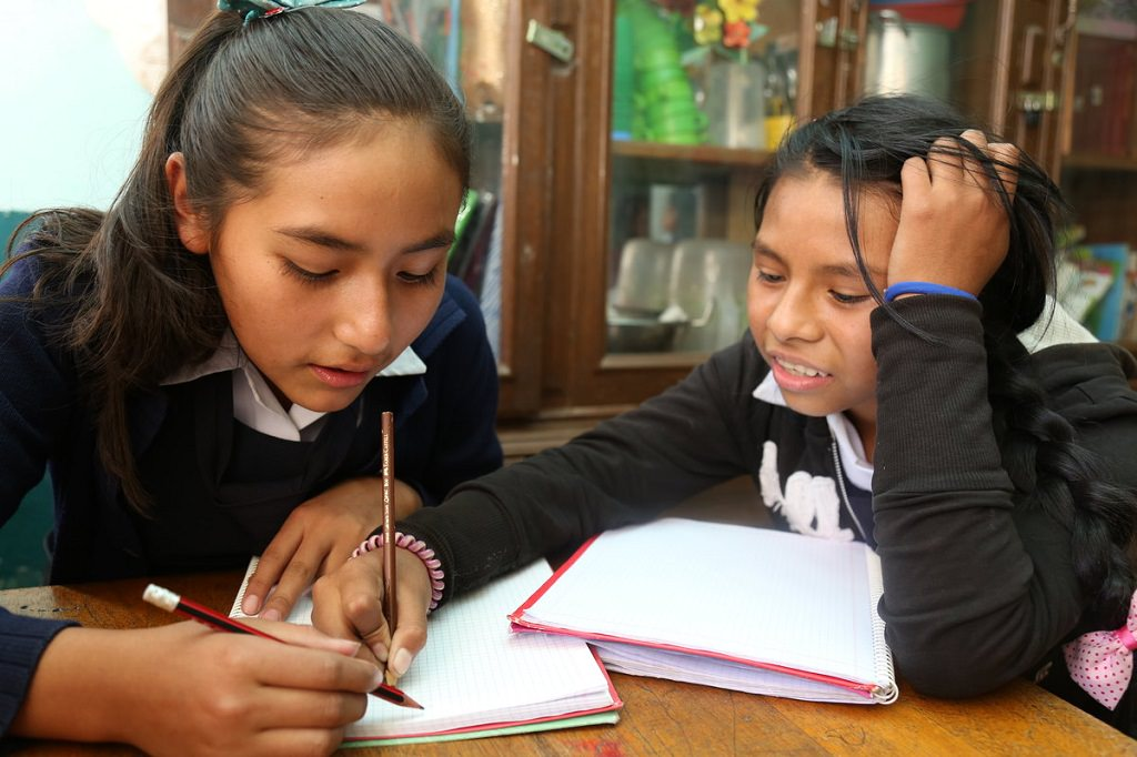 Bolivian girls doing homework