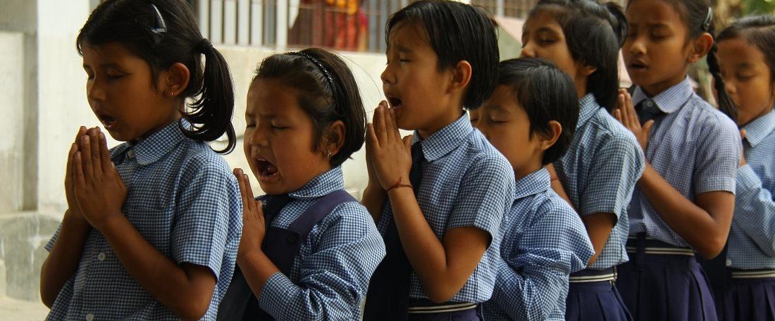 Indian children praying