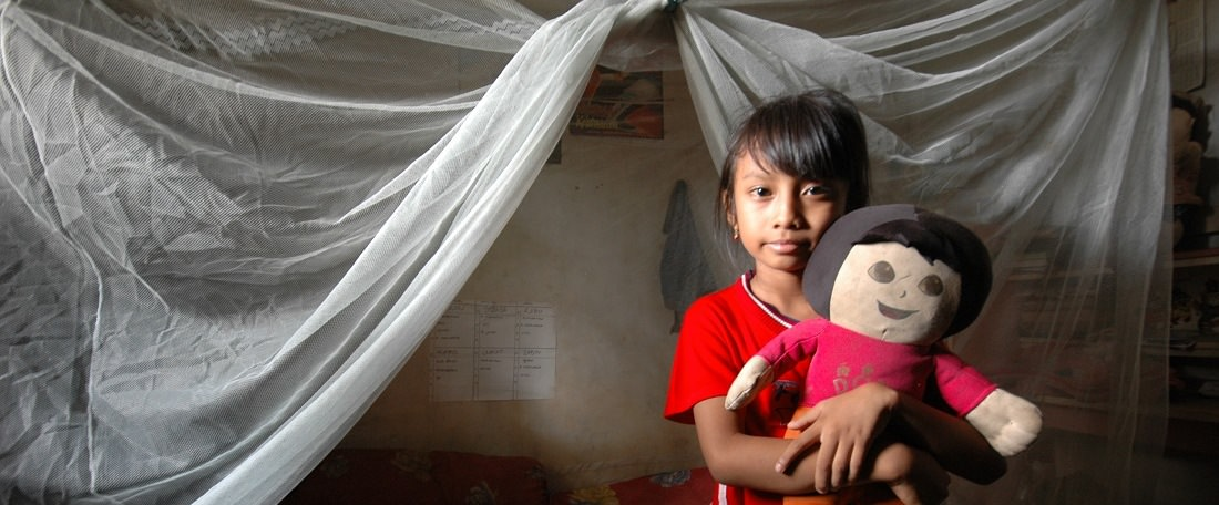 Girl with mosquito net in Indonesia