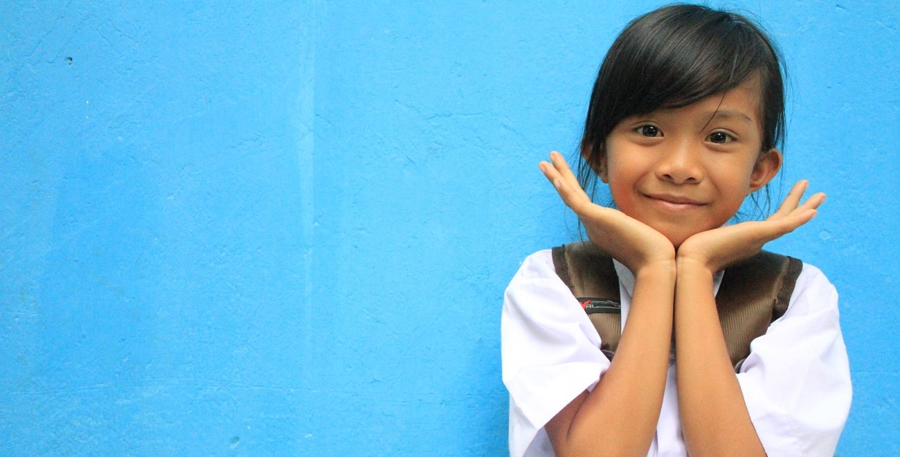 Indonesian girl smiles to the camera