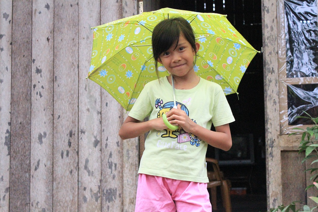 Indonesian girl holding an umbrella