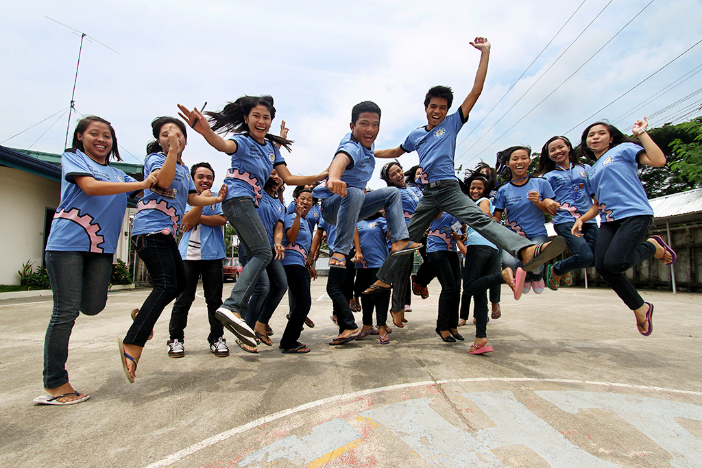 College students jump playfully on campus