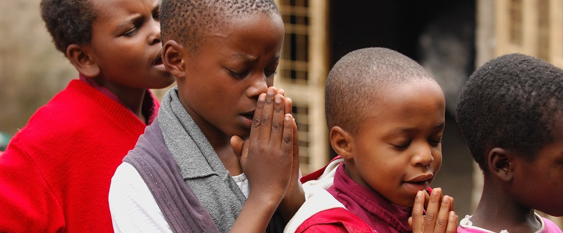 Children praying in Tanzania