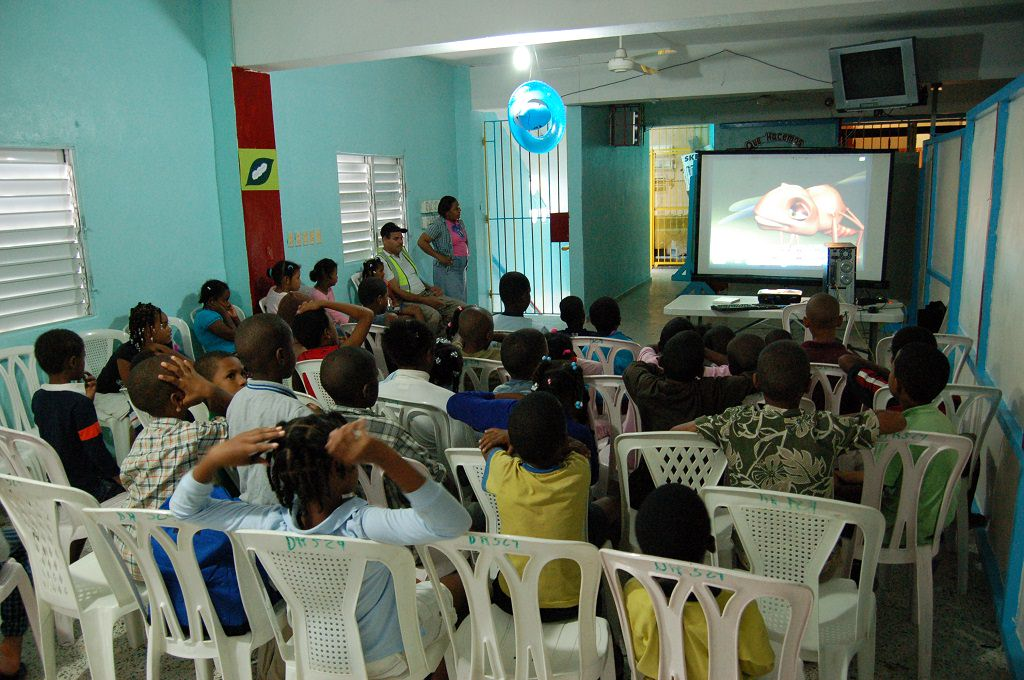 Compassion Dominican Republic children watching tv after a natural disaster