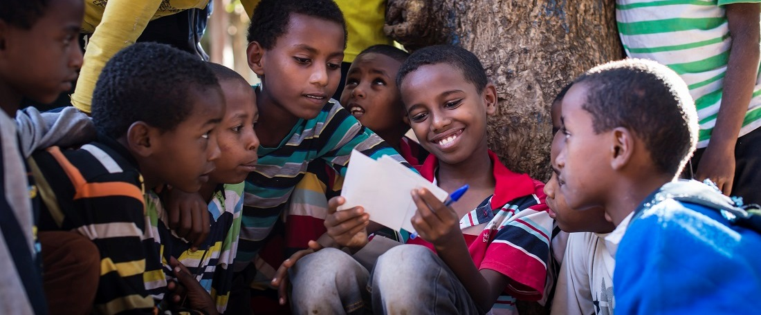 Sponsored children reading their letters in Ethiopia