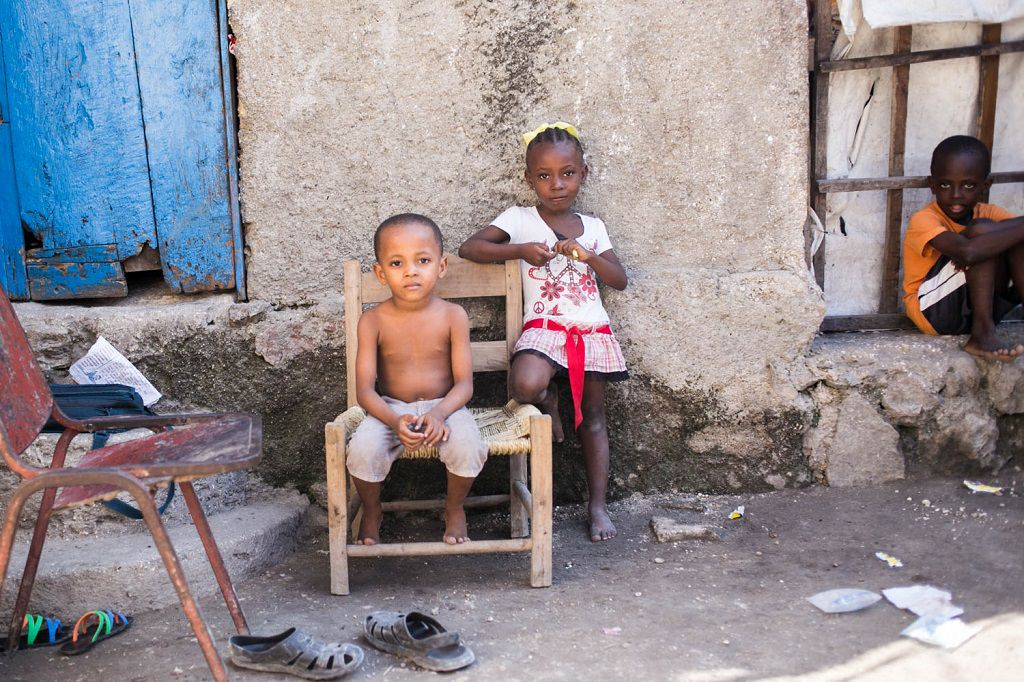 Haitian children sitting on chair