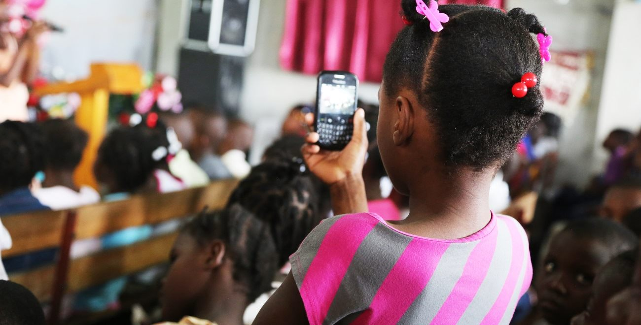 Haitian girl with mobile phone