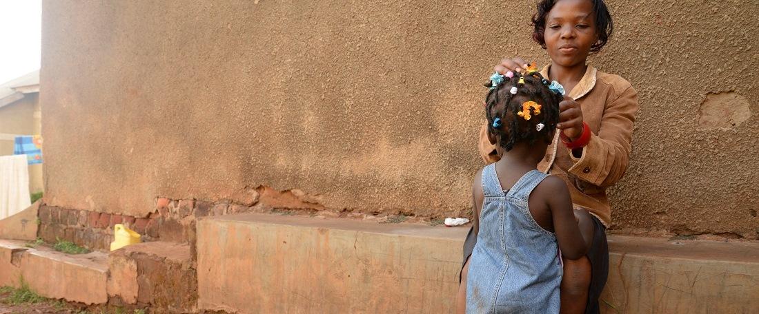 Little girl having her hair done