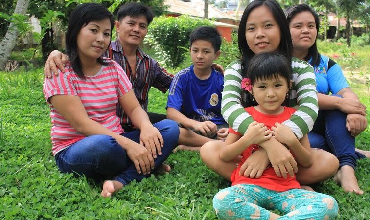 Meina and her family in Indonesia