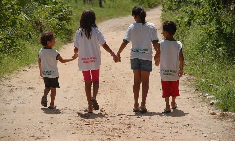 Children holding hands in Brazil