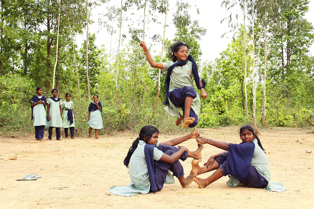 Girls play jumping game in India.