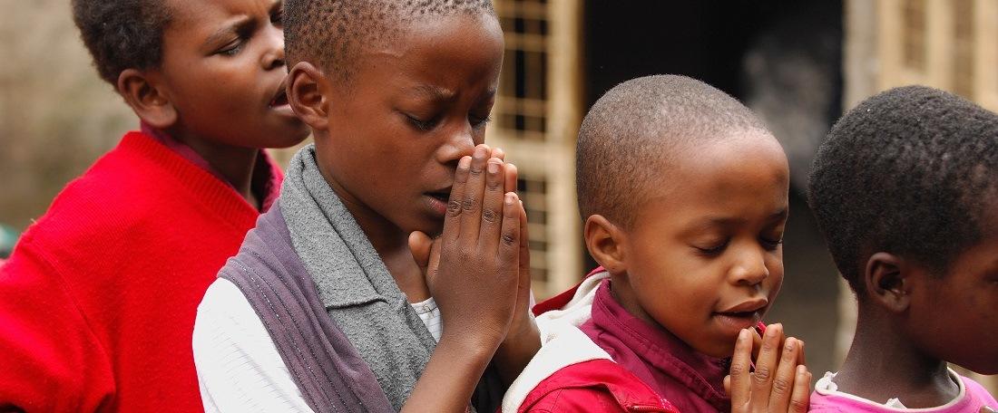 Tanzanian children praying